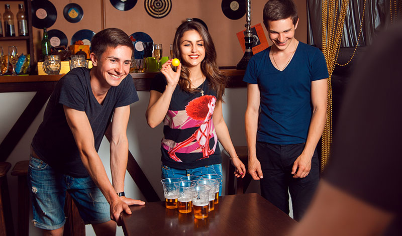 group playing beer pong