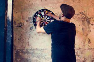 guy playing darts