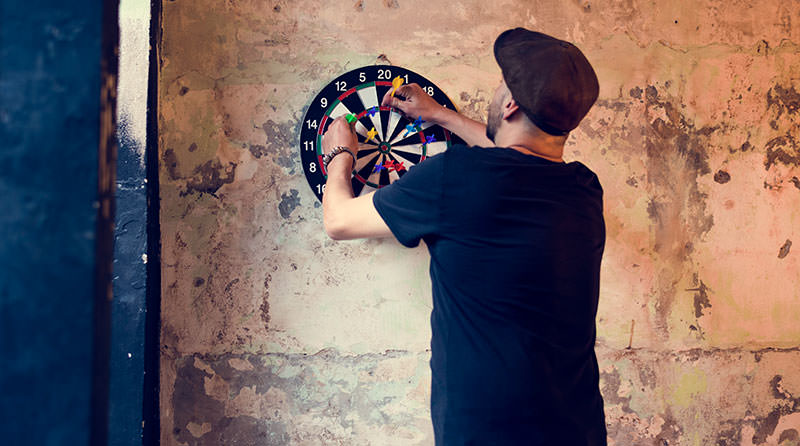 guy playing darts