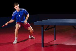guy playing ping pong