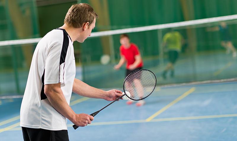 guy playing badminton