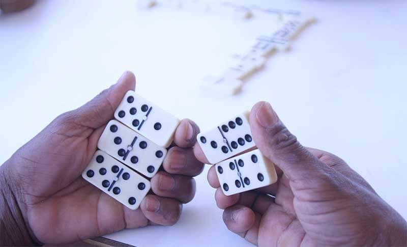 dominoes in hand