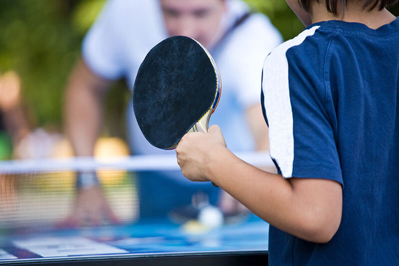 teen playing ping pong